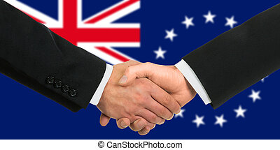 The Cook Islands flag and business handshake