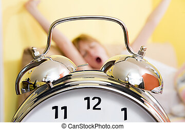 morning routine - Close up of alarm clock Young woman in the...