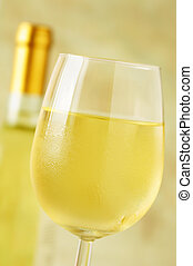 Close-up of a ice cold glass of white wine covered with...