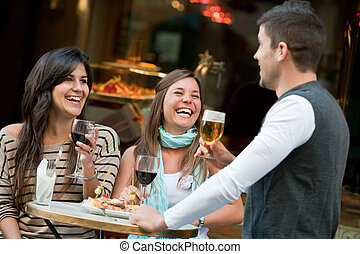 Friends having a drink. - Group of young friends having a...
