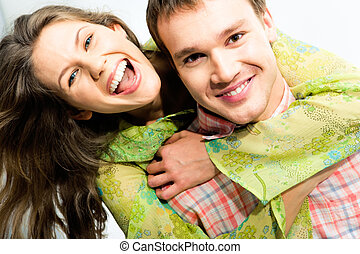 Happy couple - Close-up of beautiful woman embracing...