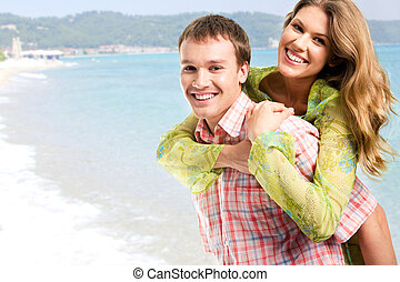 Happiness - Photo of young happy couple enjoying themselves...