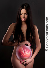 body painting of a pregnant woman and the fetus