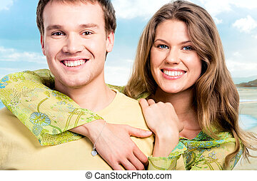 Loving couple - Portrait of pretty girl embracing her...