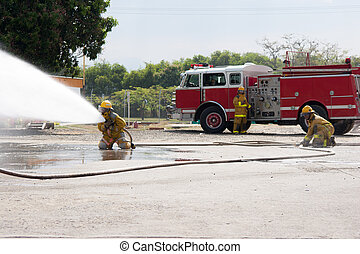 Firefighter Training - Firefighter fighting For A Fire...