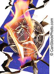 euro - A broken euro coin with a broken Greek flag in flames