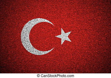 The Turkish flag painted on a cork board