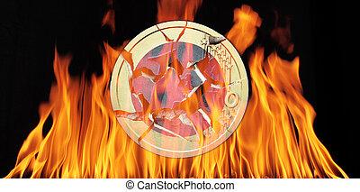 euro - A broken 2 euro coin in flames