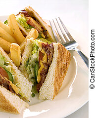 Club Sandwich - Toasted club sandwich served with french...