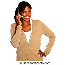 Smiling young woman talking on cellphone