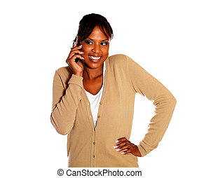 Pretty young woman speaking on cellphone