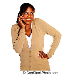 Adult woman with a happy attitude speaking on cellphone...