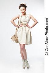 Luxurious supermodel girl posing on podium - Fashionable...