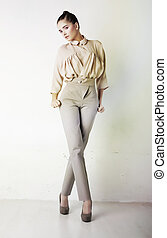 Fashion girl in white trousers and blouse posing - Perfect...