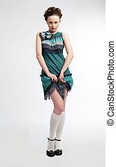 Cute young woman posing in modern green dress