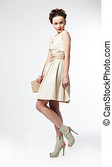 Cute woman fashion model in retro dress posing - Beautiful...