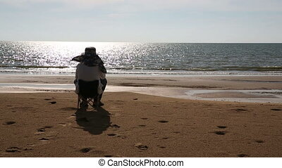 Senior man sitting at beach