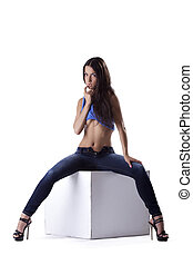 Sexy woman in jeans with long legs isolated