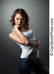 Sexy Young woman in jeans white tank top