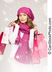 shopper - lovely woman with shopping bags over white