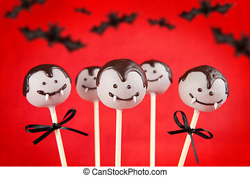 Vampire cake pops - Round-shaped mini cakes dipped in...