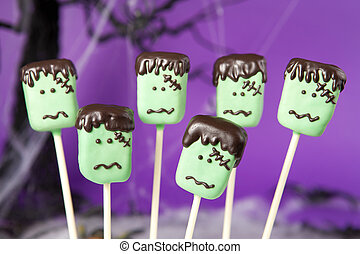 Frankenstein cake pops. Rectangular mini cakes dipped in...