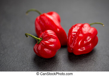 red habaneros on slate plate