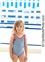 Blond kid girl with summer swimsuit in blue apartment...