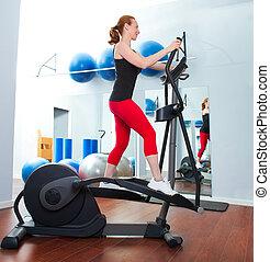 Aerobics cardio training woman on elliptic crosstrainer...