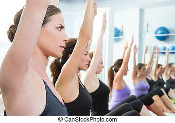 Aerobic Pilates personal trainer in a gym group class in a...
