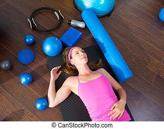 Aerobics woman tired resting lying on mat - Aerobics...