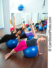 Aerobic Pilates women group with stability ball in a row on...