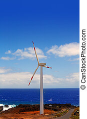 Aerogenerator windmills in front of ocean sea at Canary...