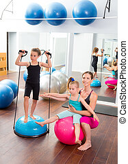 Aerobics woman personal trainer of children girl with...