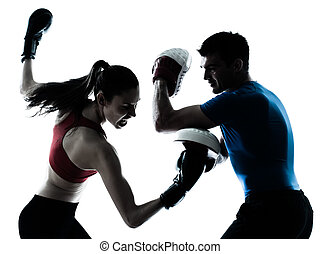 coach man woman exercising boxe - personal trainer man coach...