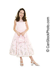 Young Girl - Young caucasian girl dressed in a Easter dress...