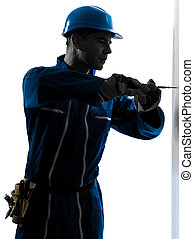 man construction worker screwdriving silhouette - one...