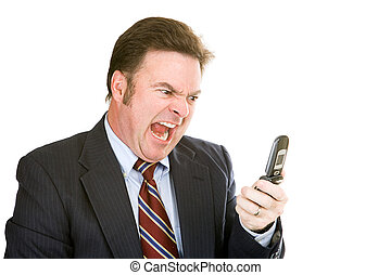 Businessman Yelling into Phone - Angry businessman yelling...