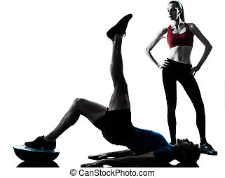 coach man woman exercising abdominals with bosu - personal...
