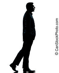 one business man walking silhouette - one caucasian business...