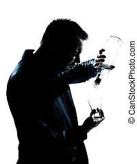 silhouette man drunk pouring empty alcohol botlle - one...