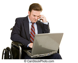 Disabled Businessman Connected - Mature businessman in...