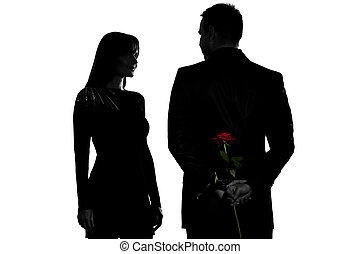 one couple man hiding rose flower and woman smiling