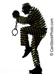 man prisoner criminal with chain ball escaping - one...