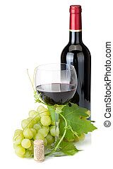 Red wine glass, bottle and grapes