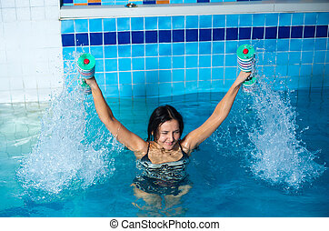 Pretty girl doing aqua aerobic exercise - Young woman...