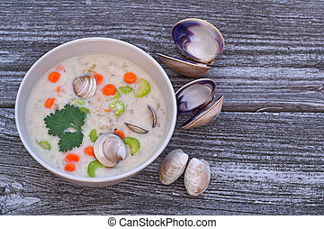 Clam chowder soup - Bowl of clam chowder soup on reclaimed...