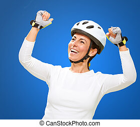 Woman Wearing Helmet Cheering Isolated On Blue Background