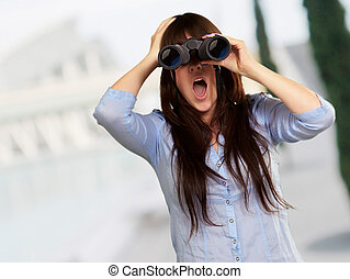 Portrait Of A Young Woman Looking Through Binoculars