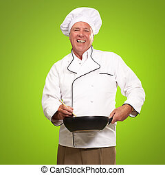 Male Chef Stirring A Non Stick Man - Male Chef Stirring A...